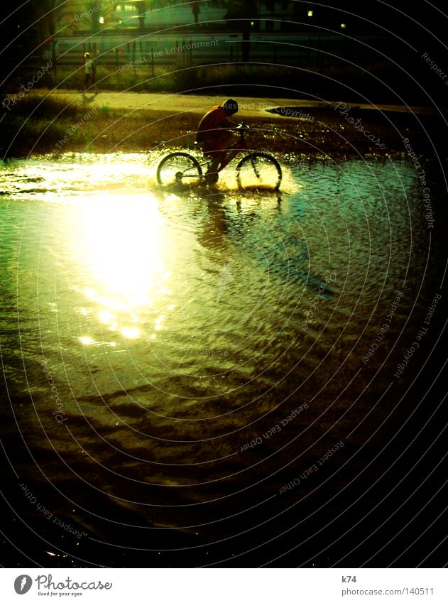 bicycle children Bicycle Tire Human being Joie de vivre (Vitality) Joy Happy Playing Romp Refreshment Refrigeration Puddle Flood Railroad Splashing Water