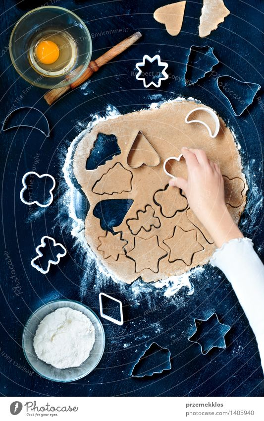 Girl cutting out the Christmas symbols in the dough Table Kitchen Human being Hand Make Cut Cutter Knife Egg Flour Gingerbread Home-made Preparation