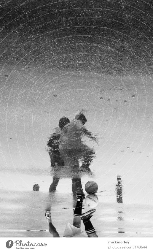 Rainwarriors Soccer Foot ball Ball Sports Drops of water Street Puddle Dribble Trick Adversary Attack Antagonism Sporting event Competition Stockings Footwear