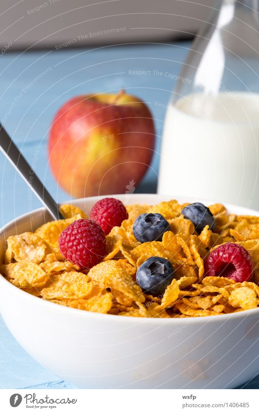 Cornflakes in a bowl Fruit Apple Breakfast Milk Bowl Wood Blue breakfast cereals Flake Blueberry Cereals raspberry Strawberry Grain Eating shell Blue background