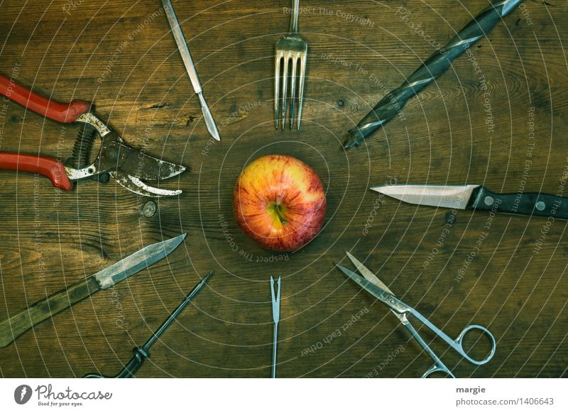 Skewers: pointed objects such as scissors, knives, forks, drills are arranged around an apple Food Fruit Apple Nutrition Knives Fork Handicraft Home improvement