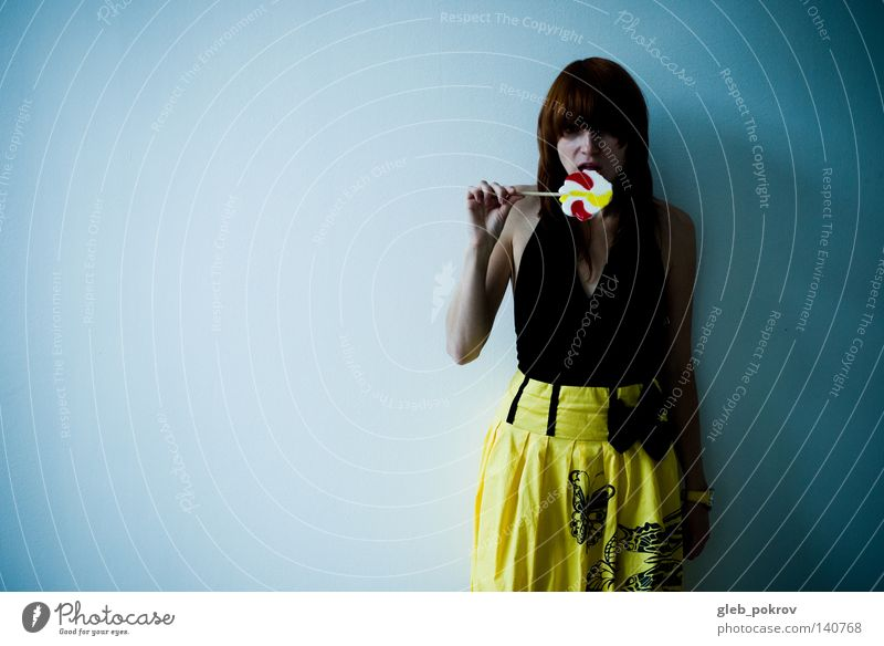 sweet. Woman Hand Black Yellow Mouth Eating Room Hair Clothing Stand Interior design Posture Dress Candy Half
