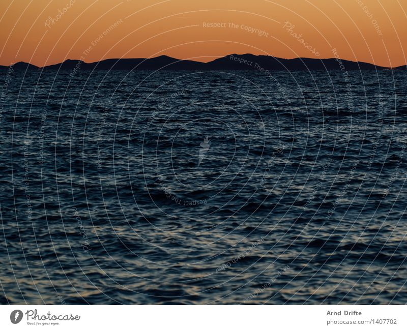 Mountains and water Vacation & Travel Tourism Nature Landscape Elements Water Sky Sunrise Sunset Summer Beautiful weather Waves Coast Bay Ocean Blue Orange