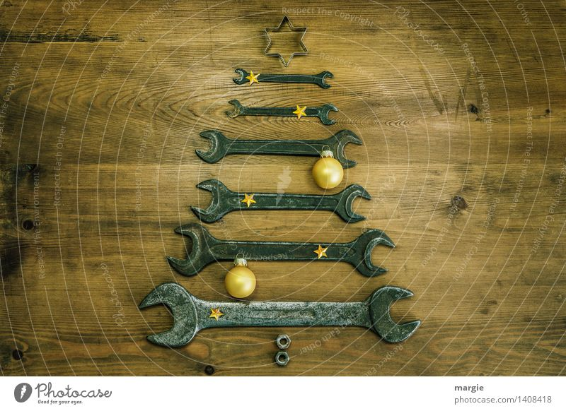 Christmas tree for craftsmen: wrenches of different sizes with yellow Christmas decoration Leisure and hobbies Playing Handicraft Feasts & Celebrations