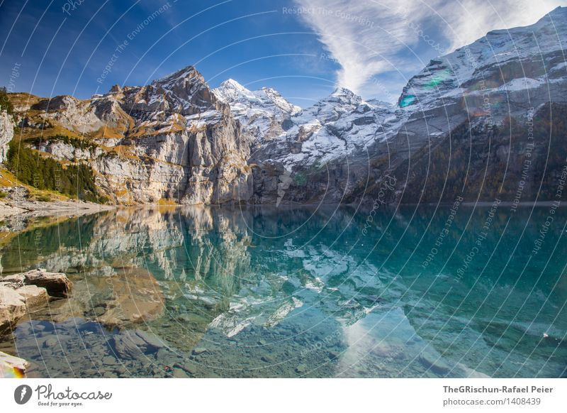 Lake Oeschinesee Environment Nature Landscape Water Sky Blue Gray Green Black Silver Turquoise White Snow Peak Mountain lake Lakeside Mirror image Reflection