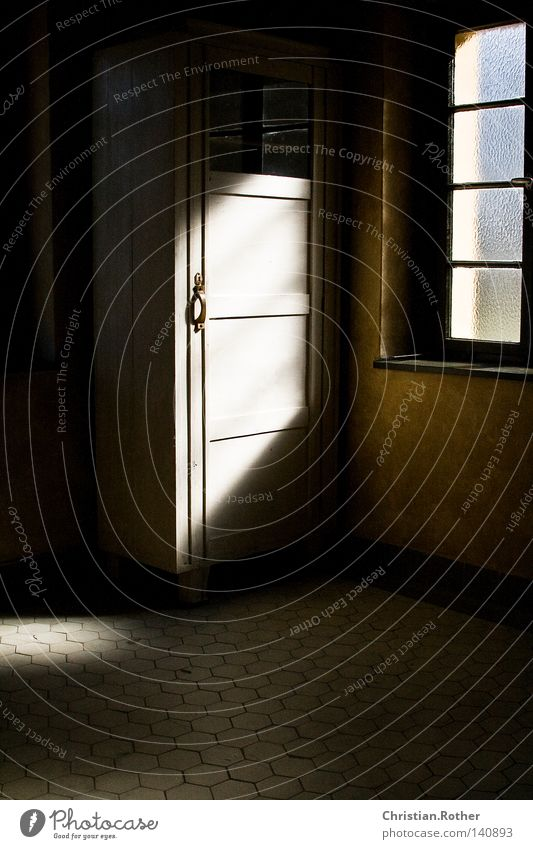 A light in the darkest hour Czech Republic Cupboard Bright Dark Door Tile Floor covering Light Sun Window Crematorium Death Cold Loneliness Grief End Repression