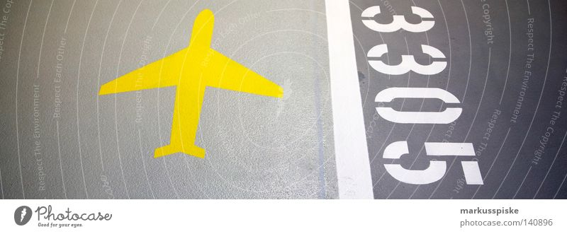 Yellow Street Gray Airplane Empty Motor vehicle Characters Digits and numbers Airport 5 Signage Story Typography Vehicle Parking Road marking