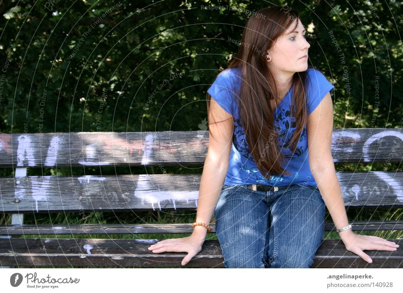 sitting and waiting Beautiful Brunette Long-haired Hair and hairstyles T-shirt Woman Hand Symmetry Wood Broken Tree Bushes Green Leaf Forest Summer Expectation