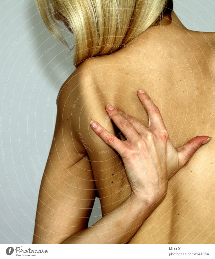 backaches Skin Woman Adults Back Arm Hand Blonde Naked Pain Shoulder Massage Wellness Colour photo Interior shot Nude photography Upper body Rear view