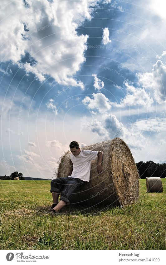 Summer Battle Desire Field Hay Bale of straw Hay bale Ball of the foot Meadow Power Force Pressure Stay Fear Roll Round Clouds White T-shirt Shirt Pants