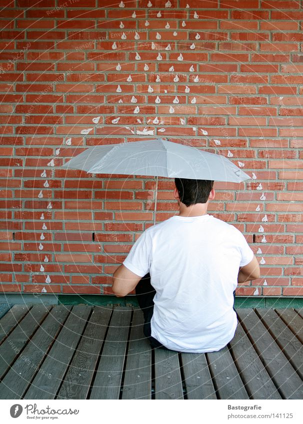 Bad weather, turn your back. Rain Umbrella Wall (building) Brick Man Gale Vacation & Travel Water Autumn Drops of water Weather Freedom Stone