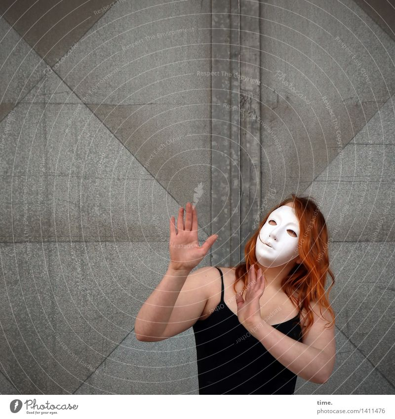 . Feminine 1 Human being Art Artist Actor Dancer Mask Wall (barrier) Wall (building) Door T-shirt Red-haired Long-haired Metal Movement Communicate Looking
