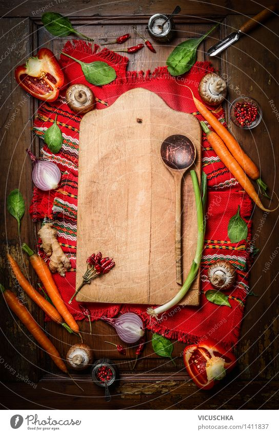 Fresh vegetables around chopping board with cooking spoon Food Vegetable Herbs and spices Nutrition Organic produce Vegetarian diet Diet Bowl Spoon Style Design