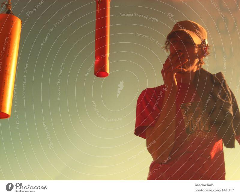COMBUSTION Sky Guy Man Fellow Human being Meteorology Weather Physics Desert Tobacco products Smoking Smoky Lamp Orange Cap Baseball cap T-shirt