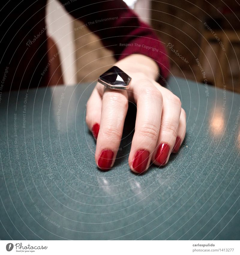# 1413277 Beautiful Feminine Young man Youth (Young adults) Woman Adults Hand Fingers Human being Ring Cool (slang) Blue Red Fingernail Table Colour photo