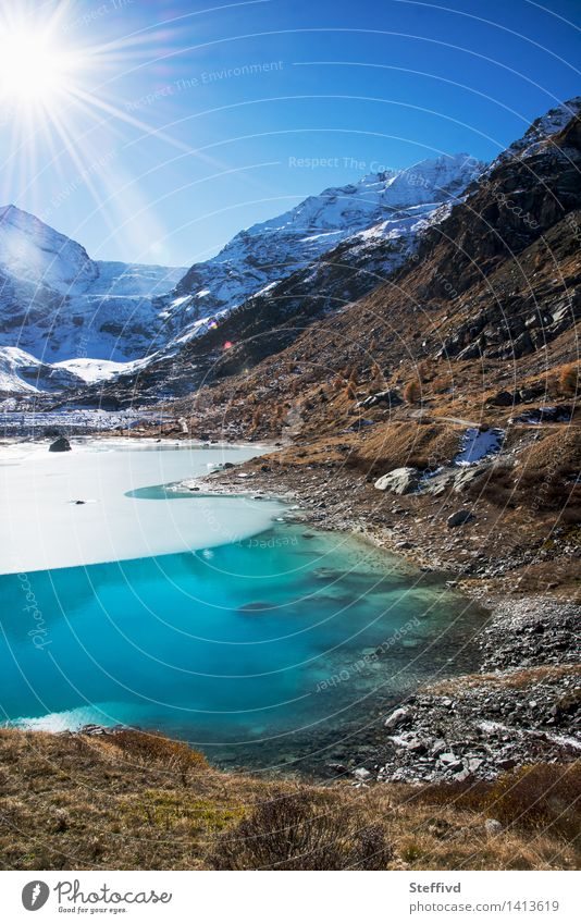 Sky Nature Vacation & Travel Water Sun Landscape Winter Mountain Environment Autumn Snow Freedom Lake Weather Leisure and hobbies Tourism