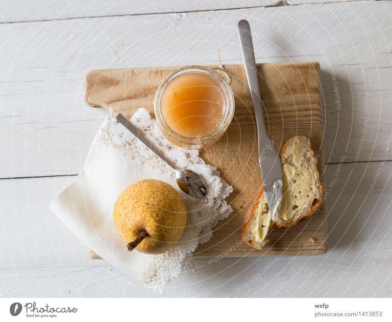 Breakfast with pear jam Fruit Jam Vegetarian diet Diet Cup Spoon String Fresh Baguette Pear pears organic Glass Preserving jar Eating Wooden table