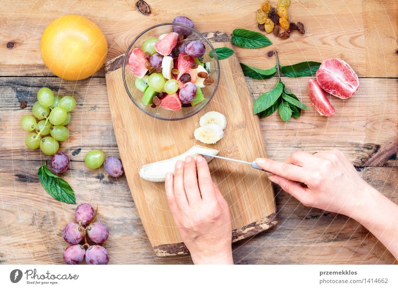 Making salad with fresh fruits Food Vegetable Fruit Lunch Vegetarian diet Diet Table Woman Adults Hand 1 Human being Wood Simple Fresh Bright Delicious Clean