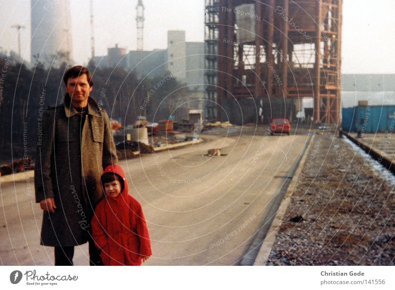 On the construction site Coal power station The Ruhr Seventies Father Workplace Planning Day Working shoes Production line Son Child Red Brown Street
