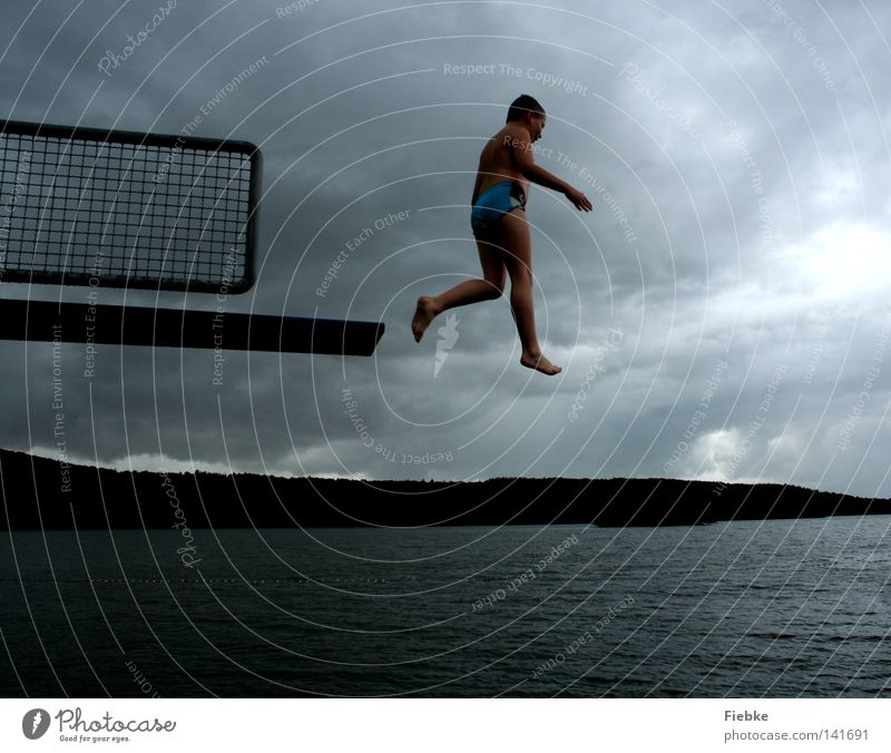 Child Sky Youth (Young adults) Water Summer Joy Clouds Black Cold Movement Boy (child) Gray Jump Lake Legs Air