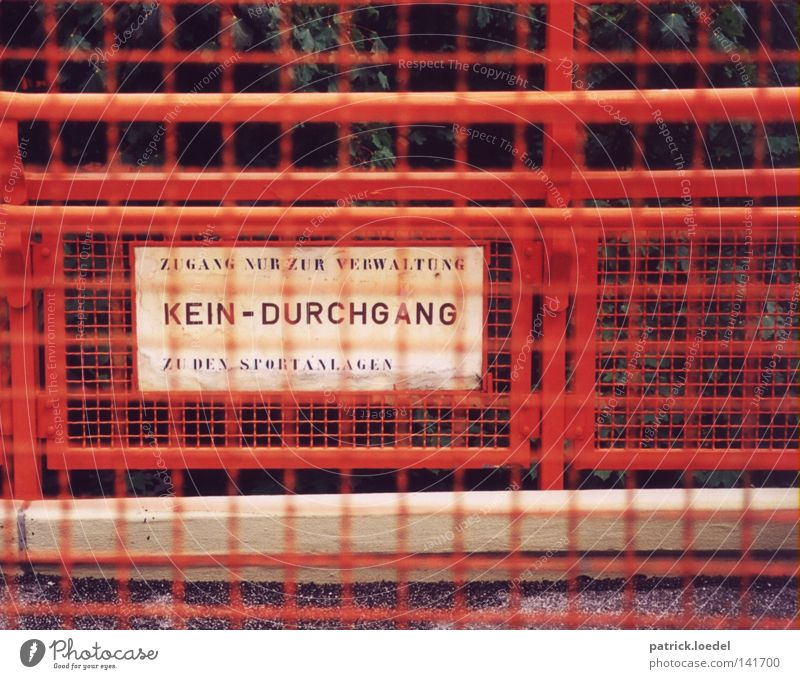 [HH08.2] Restricted zone Grating Red Rust Multicoloured Painted Barrier Passage Signs and labeling White Characters Fence Iron School building Playing