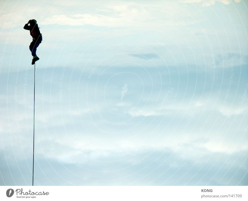 Hangs him high Sky Air Airy Hover Flying Magician Leashed Rope Bind fast Connection To hold on Clouds Mountaineering Tall Upward Above Easy Helium Aloof Release
