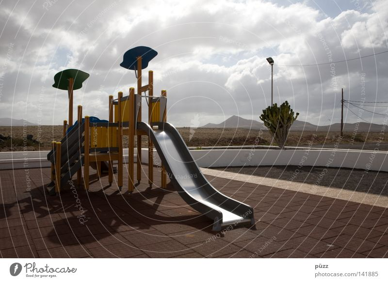 Sun Summer Clouds Loneliness Calm Far-off places Playing Warmth Empty Physics Playground Children's game Slide Lanzarote Climbing facility