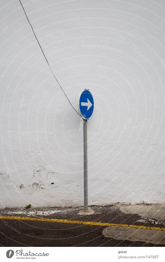 That way! Street Road sign Sign Signs and labeling Signage Warning sign Line Arrow String Blue Yellow White Wall (building) Steel cable Pole Street sign