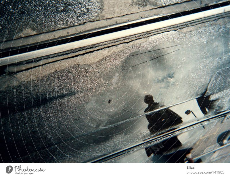 search for clues spy Surveillance In transit Agent Line Reflection Human being Hidden Search Water Wet Puddle Town Means of transport Logistics Street Asphalt