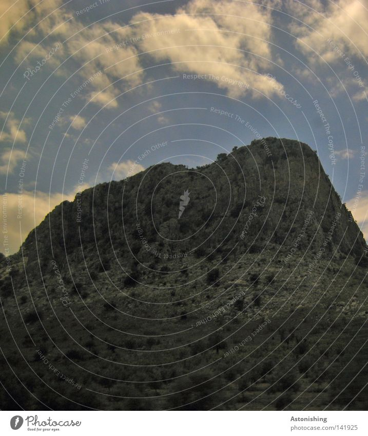 Sky Plant Clouds Dark Mountain Gray Stone Landscape Rock Spain Steep Sparse Clouds in the sky Rock formation Steep face