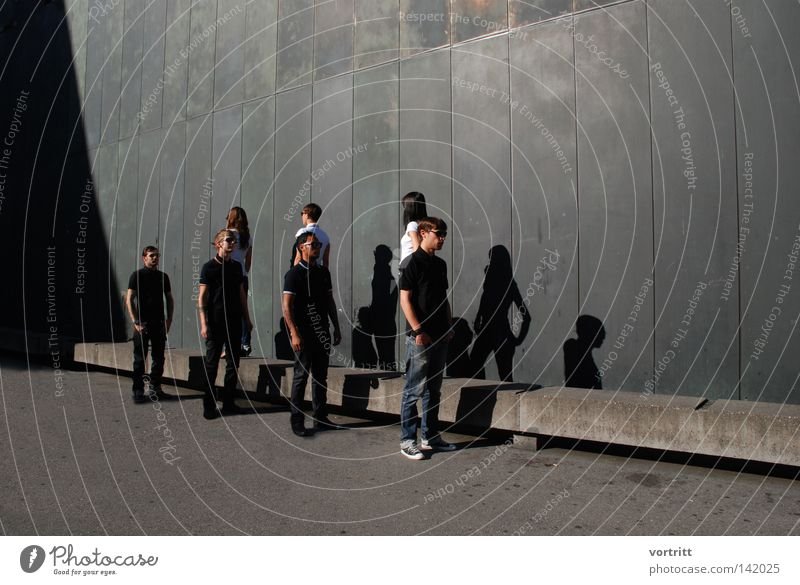 Woman Human being Man White Black Dark Wall (building) Above Group Wall (barrier) Bright Art Concrete Tall Perspective Stand