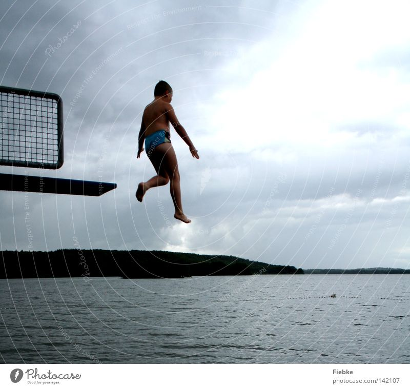 Child Sky Youth (Young adults) Water Joy Clouds Black Cold Movement Boy (child) Coast Gray Jump Lake Legs Air