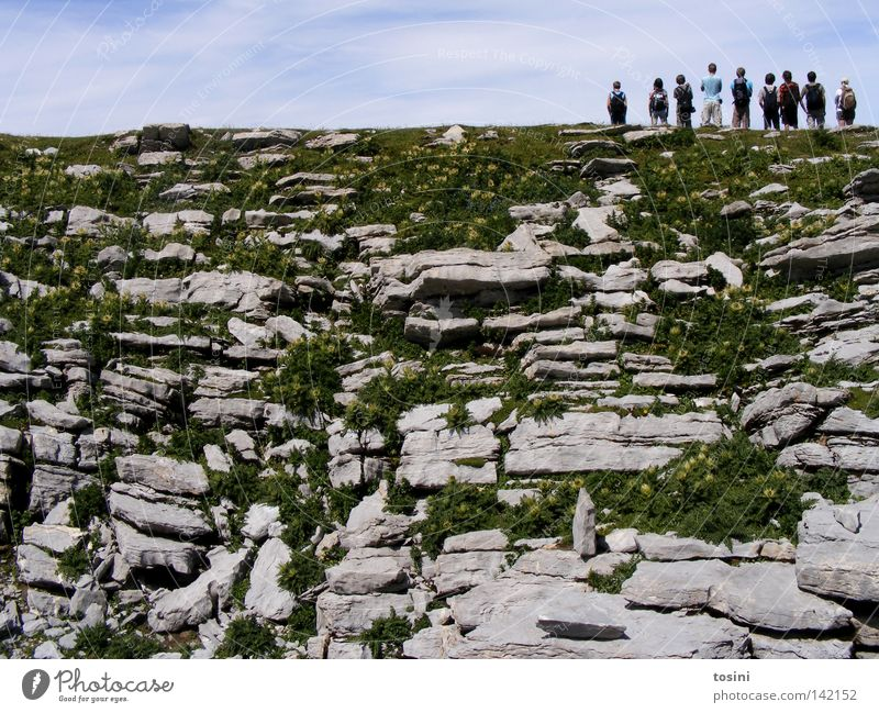Human being Nature Sky Clouds Far-off places Grass Mountain Group Stone Small Hiking Large Rock Vantage point Switzerland Backpack