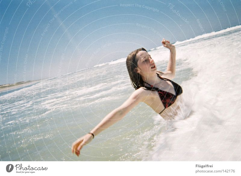Wuuuah, it's cold! Joy Vacation & Travel Freedom Summer Beach Ocean Waves Woman Adults Air Water Sky Beautiful weather Wind Coast Places Bikini Movement Freeze