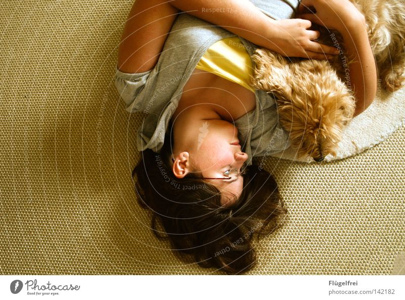 Dog Woman Youth (Young adults) Animal Calm Relaxation Adults Love Warmth Emotions Hair and hairstyles Happy Small Think Lie Friendship