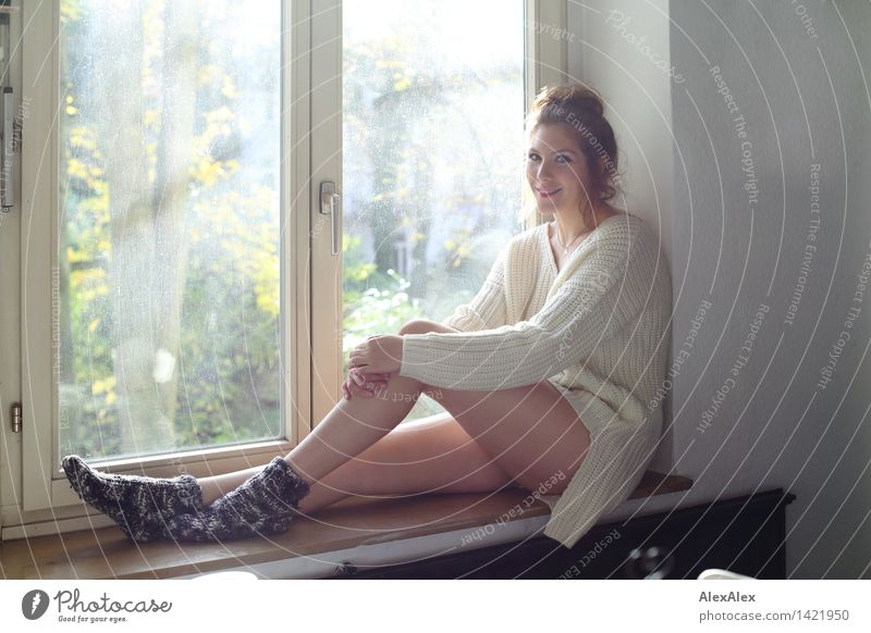 Sunday morning backlit girl's windowsill Life Harmonious Well-being Young woman Youth (Young adults) Face Legs 18 - 30 years Adults Wool socks Knitted sweater