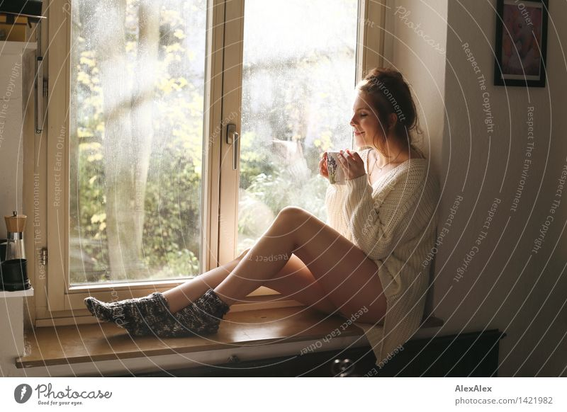 Youth (Young adults) Beautiful Young woman Relaxation 18 - 30 years Window Adults Warmth Happy Legs Body Sit Esthetic To enjoy Kitchen Coffee