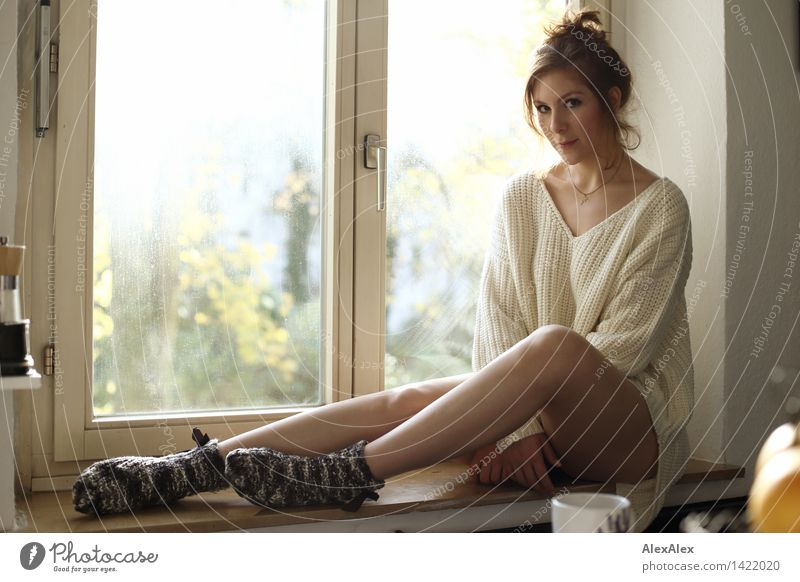 On the sunny side Happy Wellness Harmonious Well-being Contentment Young woman Youth (Young adults) Face Legs 18 - 30 years Adults Kitchen Window Sunbeam