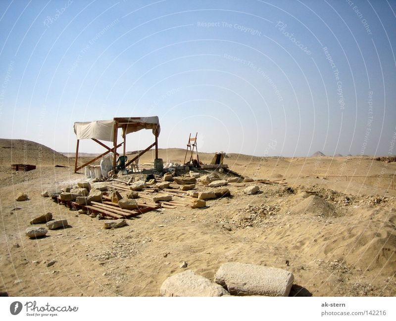 behind the pyramid Desert Sky Sand House (Residential Structure) Hut Stone Living or residing Working man Break Sun sail Weather protection Column Restoration