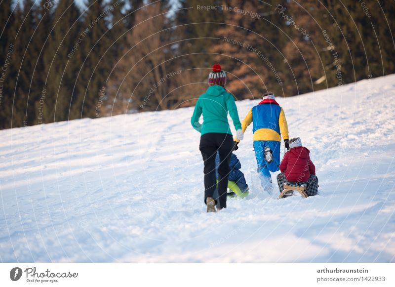 Family in winter Joy Leisure and hobbies Tourism Trip Winter Snow Winter vacation Human being Masculine Feminine Child Boy (child) Young woman