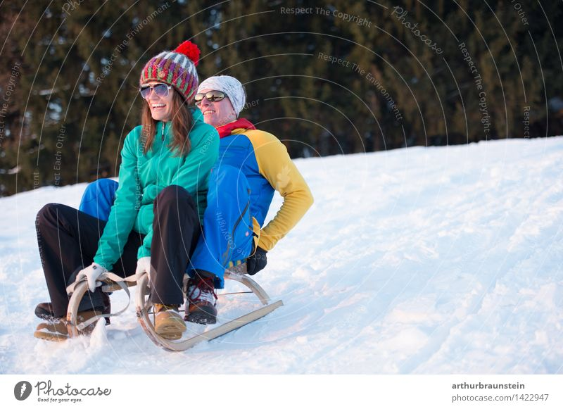 Young couple sledging Joy Leisure and hobbies Winter Snow Winter vacation Winter sports Sleigh Ski run Human being Masculine Feminine Young woman