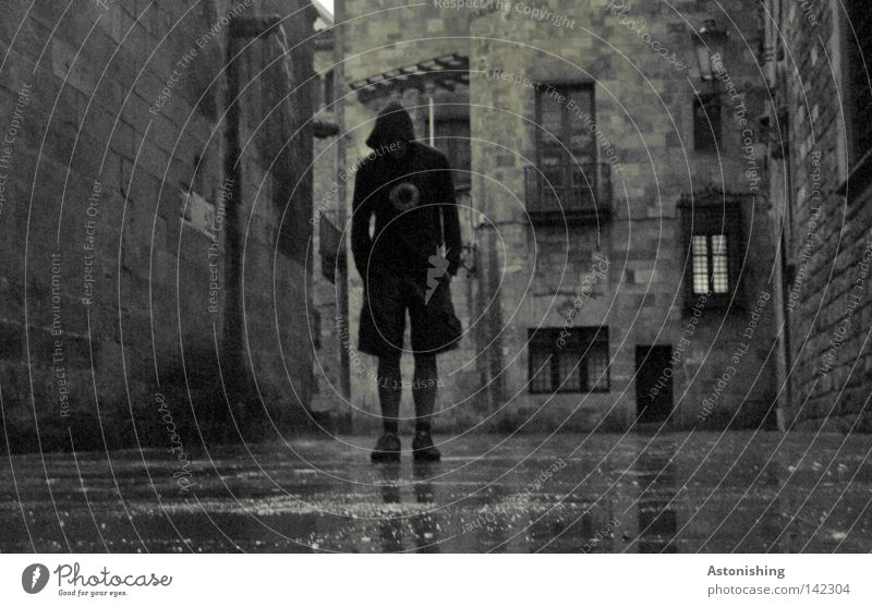 dark man in a dark alley Dark Black & white photo Contrast Colorless Man Gray Dangerous Rain Window Alley Stone Street Barcelona Stand Ground Wall (barrier)
