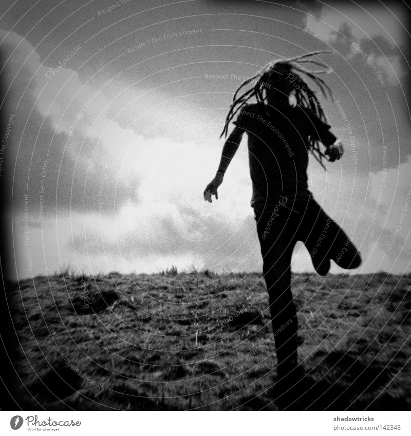 cursed Back-light Dreadlocks Holga Meadow Old Twenties Clouds Gray Black White Walking Going Escape Above Human being Mountain black and white Contrast