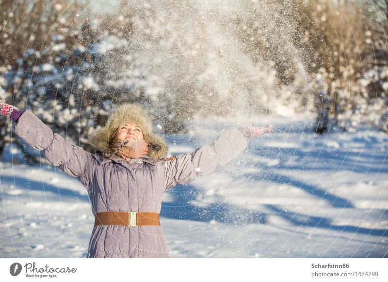 Girl enjoys the snow in winter park. Lifestyle Joy Leisure and hobbies Tourism Winter Snow Winter vacation Mountain Feminine Woman Adults Body 1 Human being