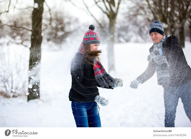 Loving couple throws snow in winter park. Human being Nature Vacation & Travel Youth (Young adults) Blue Beautiful Winter 18 - 30 years Forest Black Adults Love