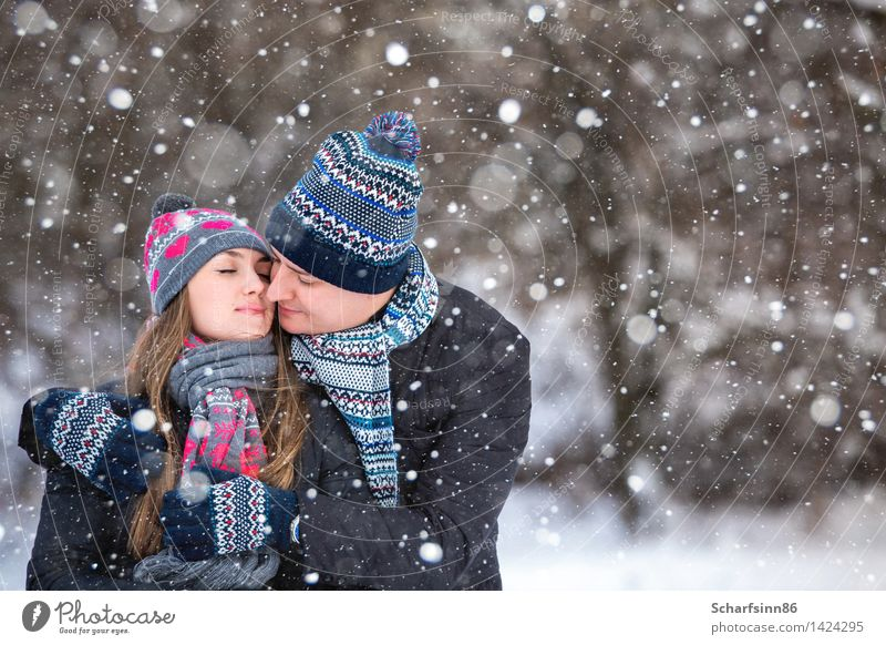 Loving couple in the winter park. Lifestyle Winter Snow Winter vacation Mountain Hiking Valentine's Day Masculine Feminine Woman Adults Man Youth (Young adults)