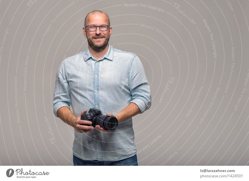 Handsome photographer with a friendly smile Human being Vacation & Travel Man Colour White Calm Face Adults Happy Gray Business Leisure and hobbies Modern