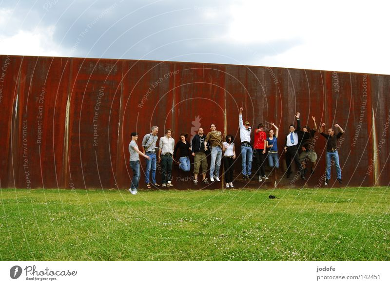 Bln 08 Jump. Group Meadow Wall (barrier) Happiness Joy Absurdity Take a photo Photographer Woman Man Human being Clouds Beautiful weather Physics Hot Sun