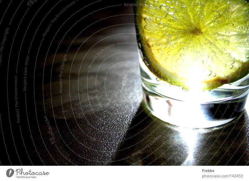 Sour makes fun :) Lemon Lime Citrus fruits Vitamin C Glass Drinking water Beverage Cold drink Thirst Summer Light Shadow Lighting Slice Yellow Green Air bubble