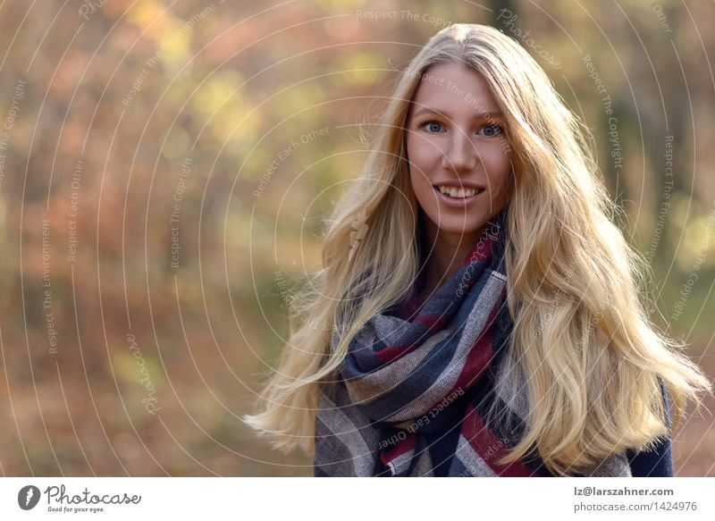 Attractive blond woman in autumn fashion Lifestyle Happy Beautiful Face Calm Sun Woman Adults 1 Human being 18 - 30 years Youth (Young adults) Nature Autumn